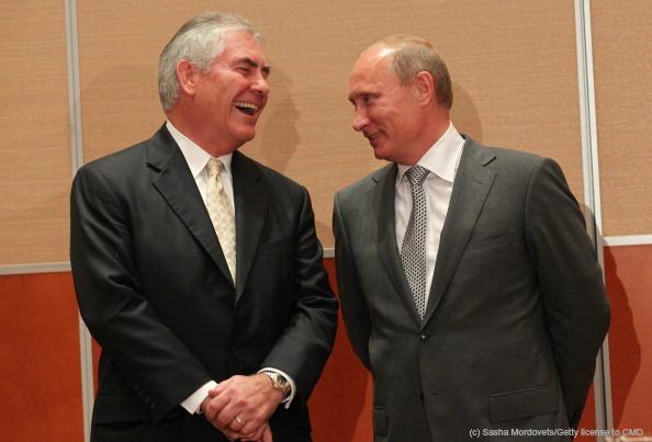 Rex Tillerson of Exxon jokes with Vladmir Putin