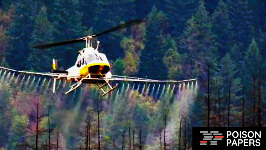 Helicopter spraying chemical on American forest