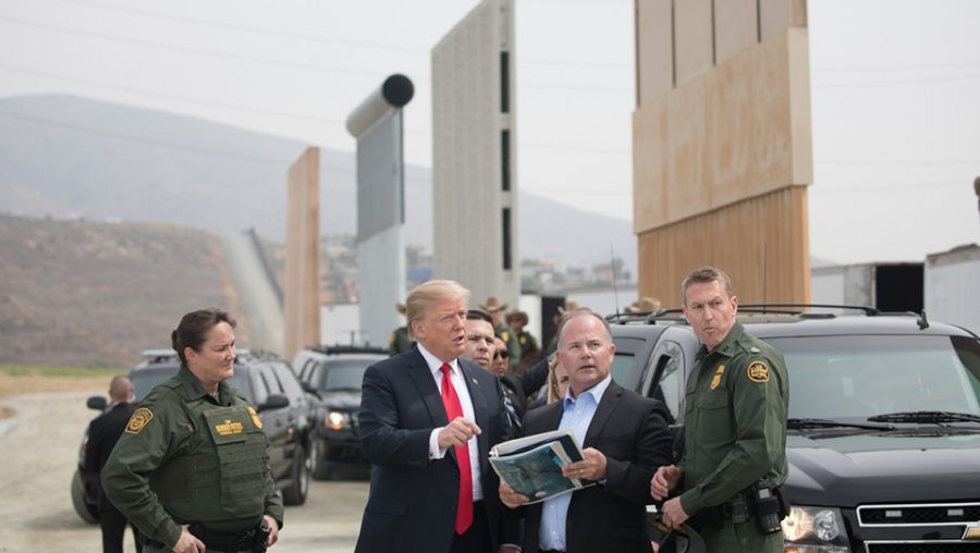 Trump examines border wall prototypes in San Diego.